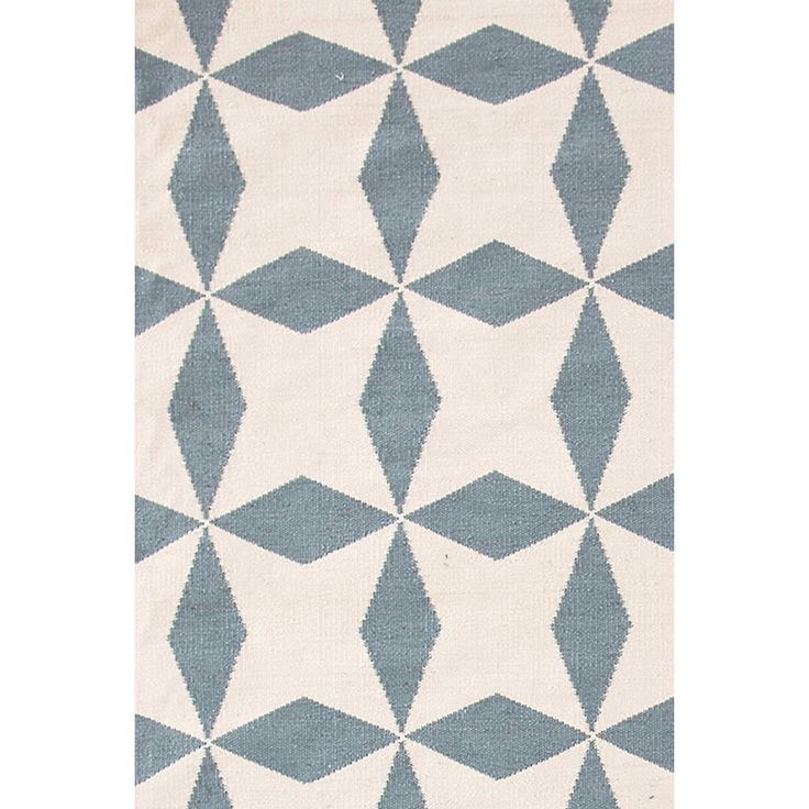 Were wagging with joy over this graphic, bold, statement-making rug, based on a vintage tile floor. Crafted of recycled materials into a durable, washable indoor/outdoor weave, its available in three fetching color combos. Due to the handmade nature, variations in color are expected.Made of 100% PET, a polyester fiber made from recycled plastic bottles.