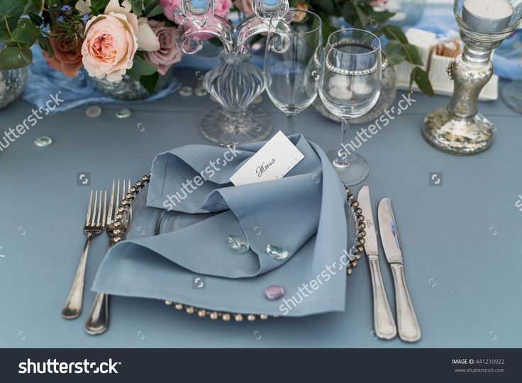 Silver cutlery lies around glass dinner plate cove…