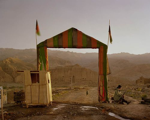 "[Image: Simon Norfolk. ""Victory arch built by the Northern Alliance at the entrance to a local commander's HQ in Bamiyan. The empty niche housed the smaller of the two Buddhas, destroyed by the Taliban in 2001."" From Afghanistan: Chronotopia.] Contrast in color leads me to contrast in feeling"