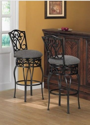 "2 Metal Bar Stool Set 30-inch Upholstered Swivel Seat Home Pub Stools CounterSit in style on these durable bar stools. The Upholstered Swivel seats are foam filled to increase comfort. The aprons and backs have a stylish scroll design with a wrought iron black finish. This pair of stools will surely impress you and your guests. Upholstered, Padded, Swivel Seats Upholstered with black and light tan textured fabric 30"" Seat height Scroll design on Backs and Aprons Durable mar and scratch…"