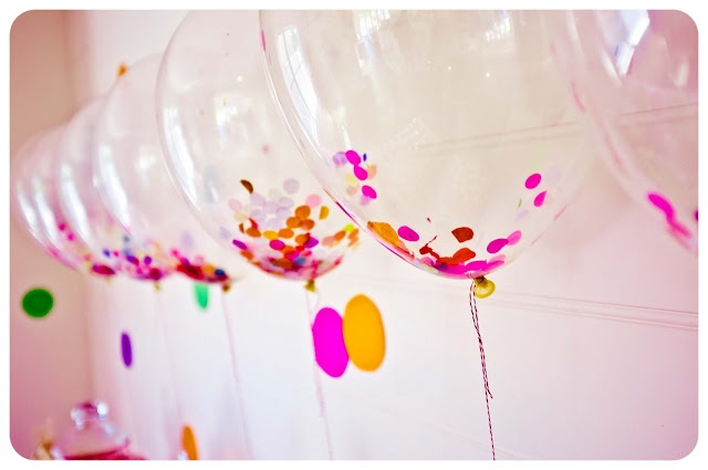 Clear balloons filled with tissue paper confetti