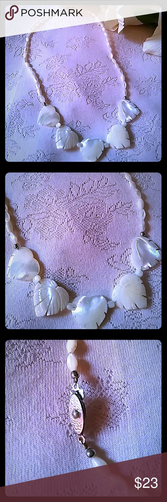 Vintage Carved Mother of Pearl Necklace Vintage item from the 1960s. Unique mother of pearl necklace consisting of beautifully carved mother of pearl heart-shaped leaves and cylindrical mother of pearl beads. Jewelry Necklaces