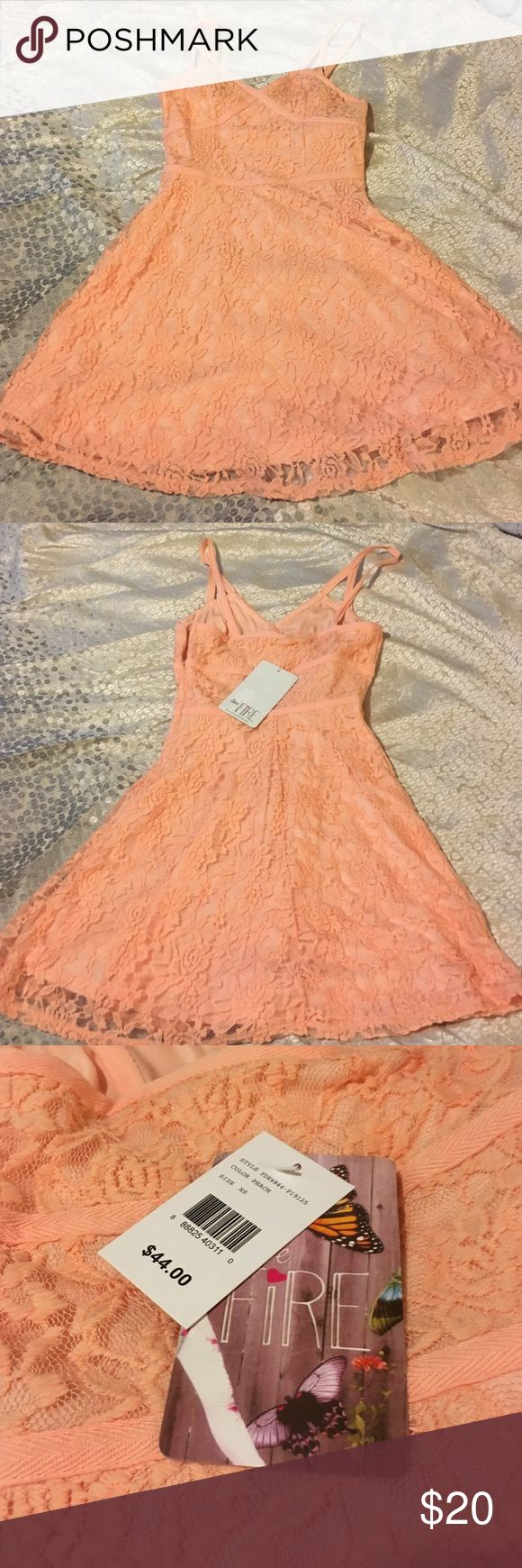 Gorgeous Nordstrom peach lace dress BEAUTIFUL DETAILED NORDSTROM DRESS. Never worn, New with tags. love, fire clothing Dresses Midi