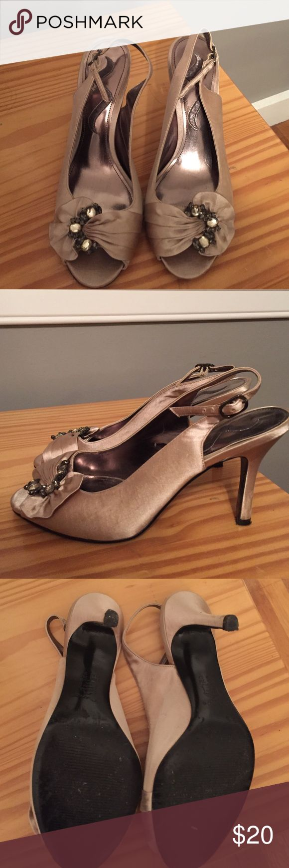 Nina champagne heels size 7 Like new Nina champagne heels size 7. Only worn once in a wedding. Beautiful detail with crystals on toe Nina Shoes Heels