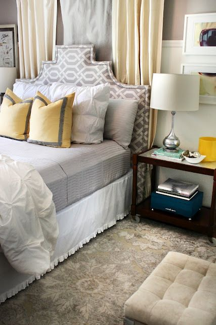 Beautifully understated gray and yellow bedroom....love that pattern on the headboard!