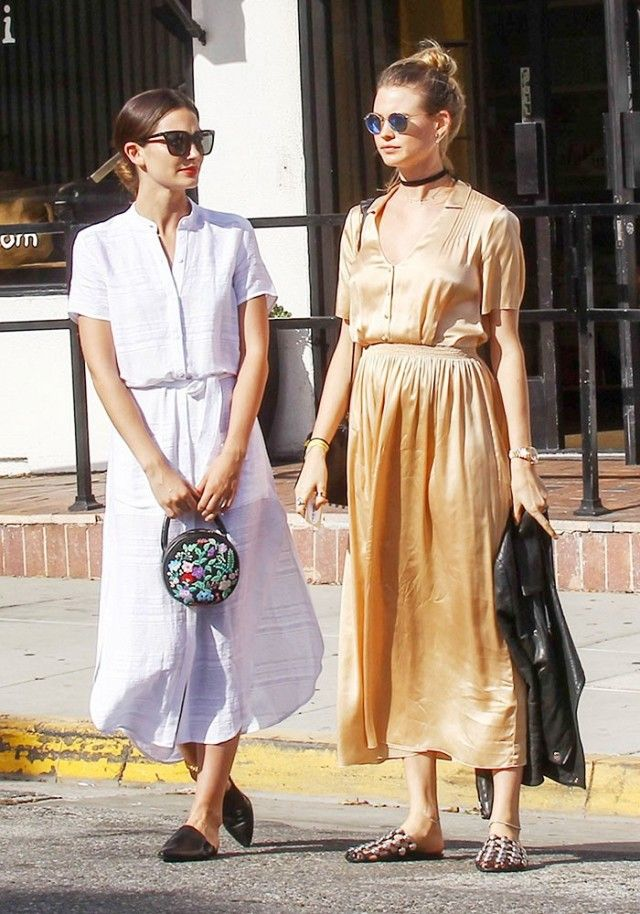 Lily Aldridge and Behati Prinsloo wear similar frock + mules looks on a day out.