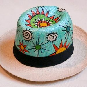 Weaved Panama hat featuring a hand-painted crabs design. Get your very own hand painted genuine Panama hat straight from the source in Ecuador. All hats are hand painted by artist María José Félix in Guayaquil, Ecuador. The hats are 100% woven toquilla straw. Slight variations in design and color will occur, as each hand-painted hat is unique and...