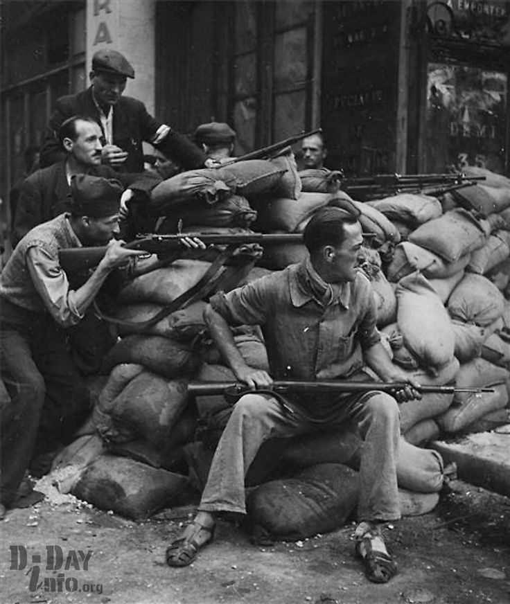 Members of the Maquis (French resistance) barricade themselves against the Germans during the liberation of Paris.