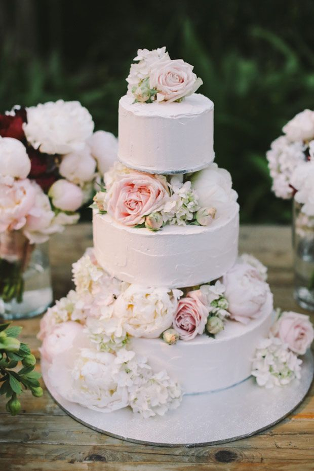 beautiful white cake with a soft palette of florals | www.onefabday.com #shabbychicwedding