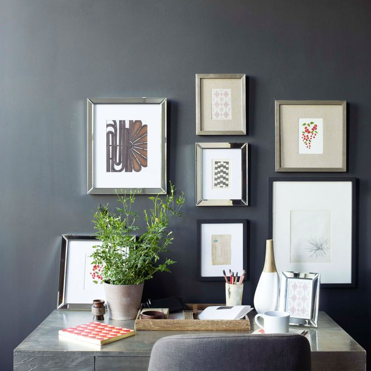 When done right, they look great, but starting out with a ton of unstructured space can be overwhelming. There's no fail-safe how-to for putting a gallery wall together, but an array of black, white, and mirrored frames help achieve a cohesive look. Learn more at West Elm. Courtesy of West Elm  - Redbook.com