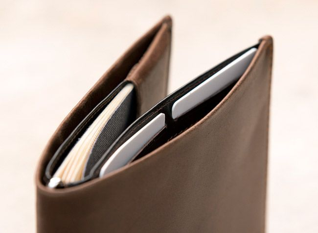 Bellroy's travel wallet has four quick access slots and a tiny pen – perfect for filling out quarantine cards at LAX or, preferably, taking down the number of your travel companion.  http://sorrythanksiloveyou.com/high-roller-male/cocoa-travel-wallet-bellroy