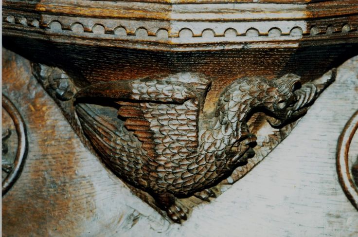the 'gastrocephalic' dragon without fleeing putti -- misericord in Beverley Minster, carved in 1520 -- for printed Horae source SEE PREVIOUS