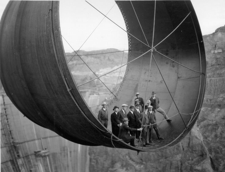 Building the Hoover Dam // Penstock pipe being lowered with the bigwigs aboard - Obviously a publicity photo