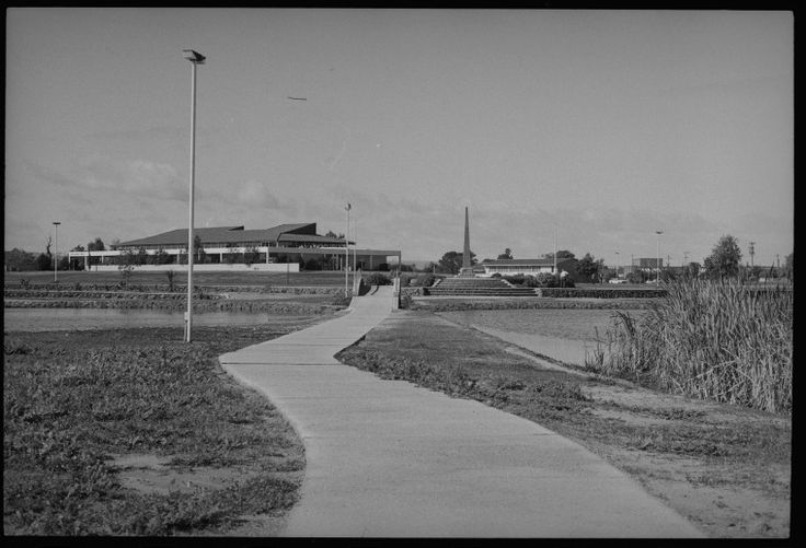 244125PD: View along footpath and over bridge to Ruth Faulkner Library, ca. 1970. https://encore.slwa.wa.gov.au/iii/encore/record/C__Rb3763688