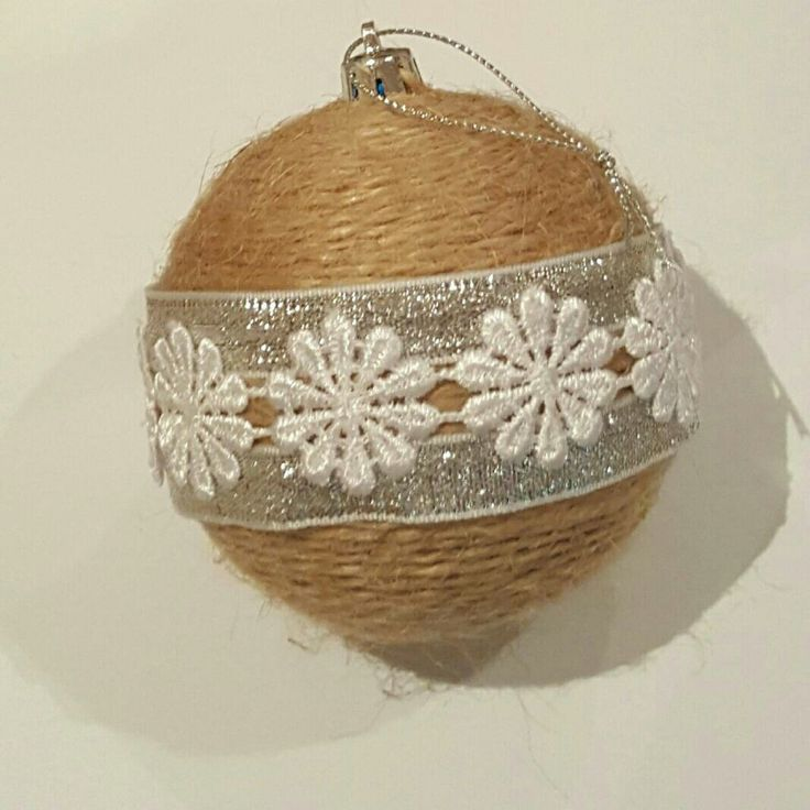 Gorgeous handmade christmas ornaments jute twine silver ribbon and white lace.