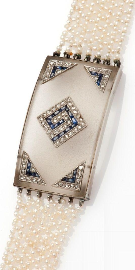 An Art Deco white gold, glass, pearl, sapphire and diamond bracelet, circa 1925. #ArtDeco