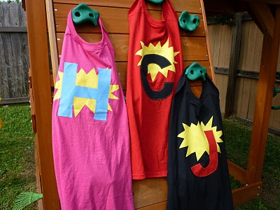 "Superhero capes - I used youth size XL tshirts instead of the suggested ""ginormous"" tshirt. That way, the neck was not too big, so I just left it intact for pulling off and on. So easy--just cut from the back of a tshirt a cape shape, and decorate as you please."