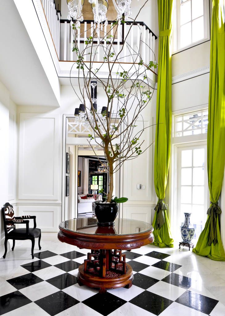 The lime green curtains against these white walls commands attention!
