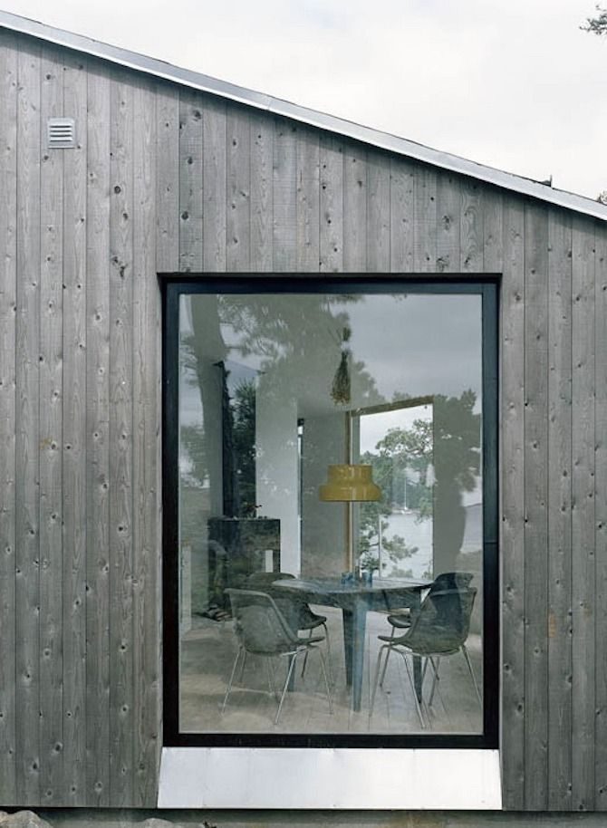 Pine facade treated with iron vitriol. CLAESSON KOIVISTO RUNE: Kråkmora Holmar vacation house