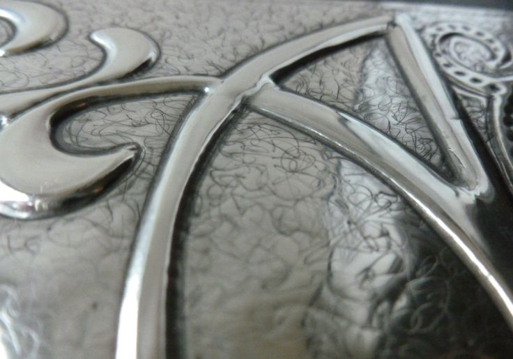 Close up of lettering. Pewter Concepts