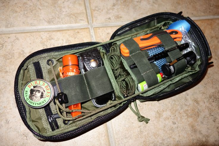 Maxpedition FR-1 bag, Knives of Alaska Scout, S&W tac pen, Armytech flashlight, Bic, Swis Army, whistle-compass-matches, emergency blanket, first aid items, Burts Bees