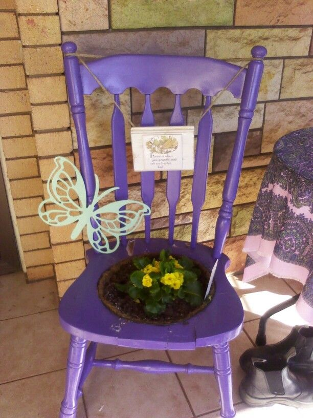 Old chair painted and turned into plant pot