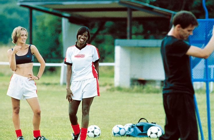 """Bend It Like Beckham"" movie still, 2002.  L to R: Keira Knightley, Shaznay Lewis, Jonathan Rhys-Meyers."