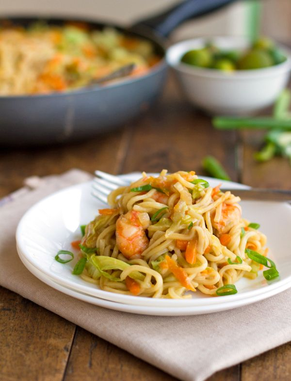 Stir Fried Noodles With Shrimp And Vegetables - shrimp - oil - 3 garlic cloves - onion - green cabbage - carrots - dry pancit canton noodles - chicken stock - low sodium soy sauce - fish sauce - lime - green onions - Pinch of Yum