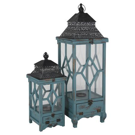 Add an atmospheric touch to your patio or living room with this set of two metal and wood lanterns. Finished in vibrant turquoise tones, they effortlessly en...