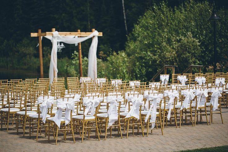 Beautiful seating arrangement overlooking the pond at Elk Ridge Resort, SK.  https://mjand.co/elk-ridge-resort-wedding-photography/ Marriage on the Pond - MJ&Co. Wedding Photographers