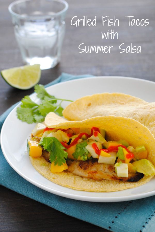 Grilled Fish Tacos with Summer Salsa - Cumin-rubbed grilled tilapia topped with avocado, mango, jicama and cilantro. | foxeslovelemons.com