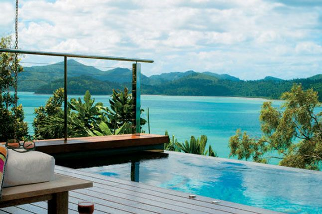 Infinity plunge pool overlooking the Great Barrier Reef in the Whitsundays, at Qualia, Hamilton Island, Australia.