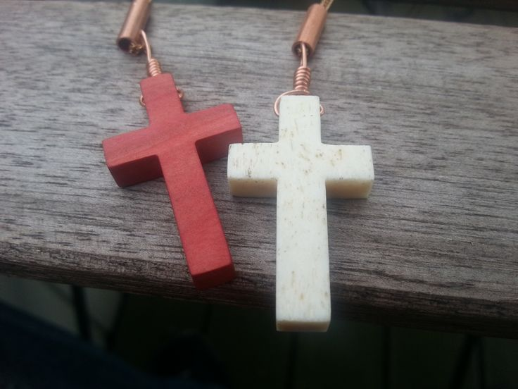 IMNLV Camel bone and pink ivory wood cross necklaces.
