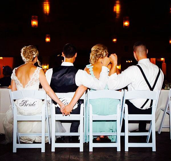 Bride and maid of honor holding hands. And groom and best man fist pump. Great idea