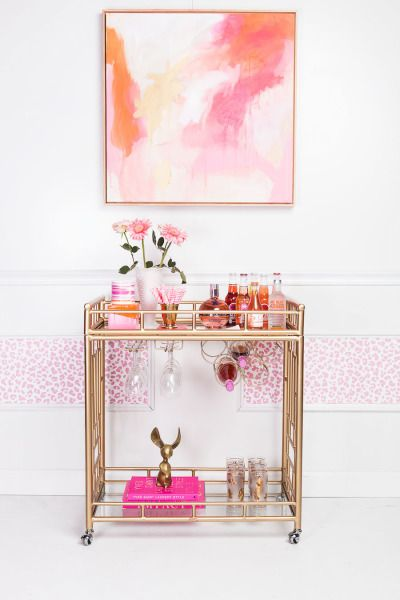 Pink hues and a gold bar cart! http://www.stylemepretty.com/living/2015/07/08/three-ways-to-incorporate-wallpaper/ | Decor: Society Social - http://www.shopsocietysocial.com/