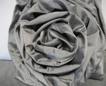 Tutorial to make rose pillow from an old skirt!  could be used to make rosettes for chairs for any occasion.