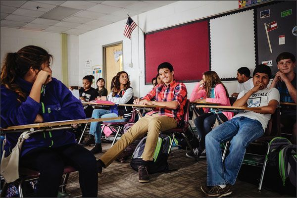 Students chat in an 8th grade social studies class at Valley Point Middle School in Dalton, Ga. The schools enrollment shifted to a majority of nonwhite students last school year.