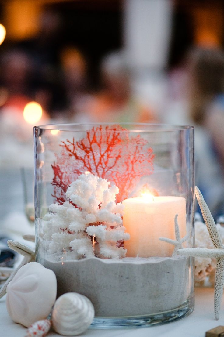 Be creative with your candle displays. Candle light is essential when creating a romantic look. To add interest to the candles whilst there is still daylight, pieces of washed up coral thrown in with the sand, work really well.