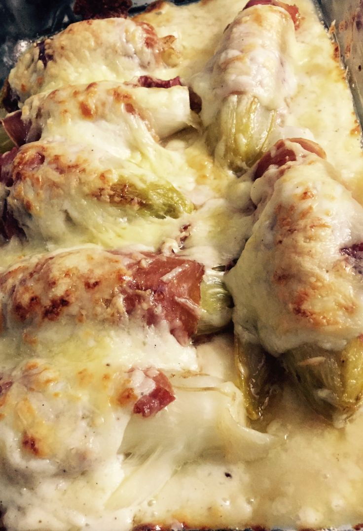 Belgian endives wrapped in ham and baked in a creamy, cheesy béchamel sauce. What's not to love?