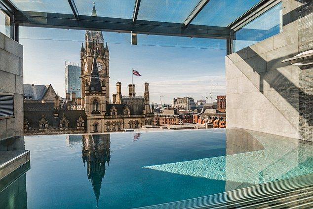 The rooftop pool looks out over the Manchester skyline, directly across from the Town Hall...