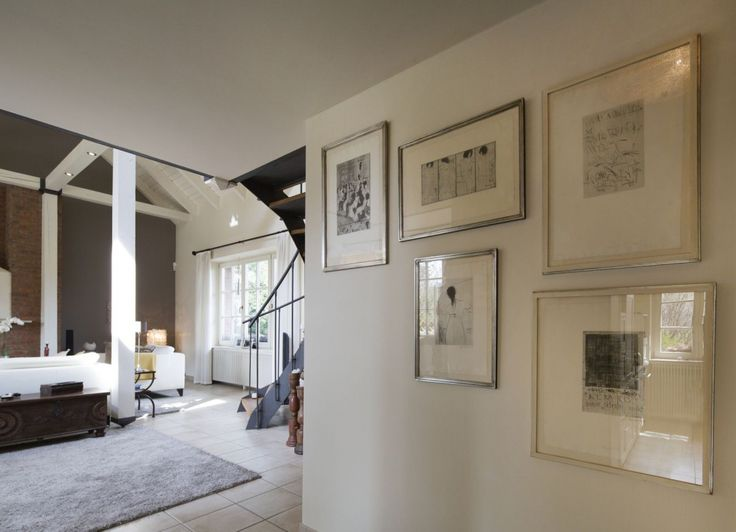 Collection of black and white paintings in the silver frame on the wall