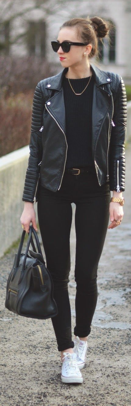 A Black Sweatshirt With A Leather Jacket And Black Jeans With White Converse And A Black Purse With A Gold Necklace