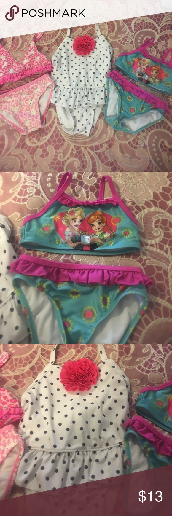 Girls 3T swimsuit lot. Frozen, Hello Kitty 2 bikinis and a one piece all 3T. The Frozen suit and the one piece are in perfect shape the Hello Kitty bottoms are really faded the top is fine. Swim