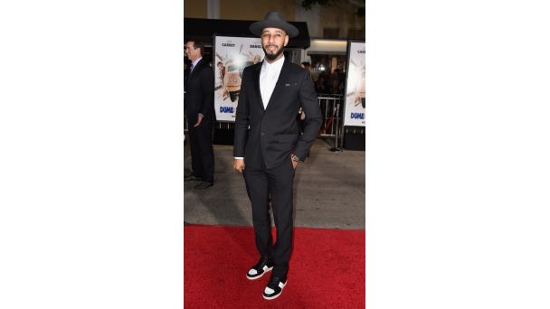 Out and About: The Cool Factor Swizz Beatz is dapper in his suit, hat and sneaks arrives at the premiere of Dumb And Dumber 2 in Westwood, California.