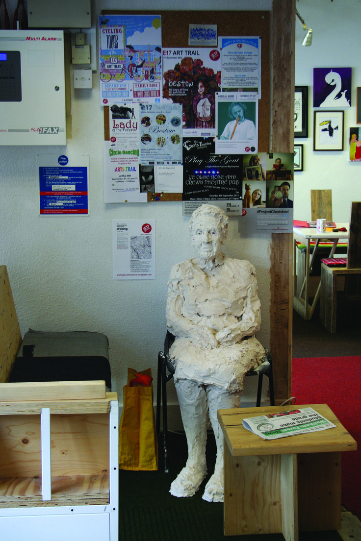 Waiting: life-size plaster sculpture in a community centre