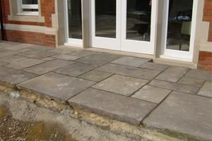 Work in progress, you can see the care that has been taken creating this random patten using reclaimed york stone flags