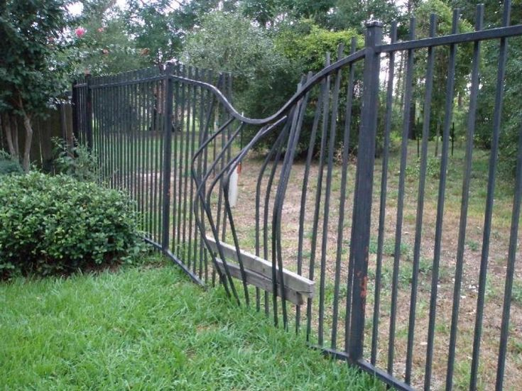 Fixing Tree Damage To A Steel Fence Will This Gate Be Too