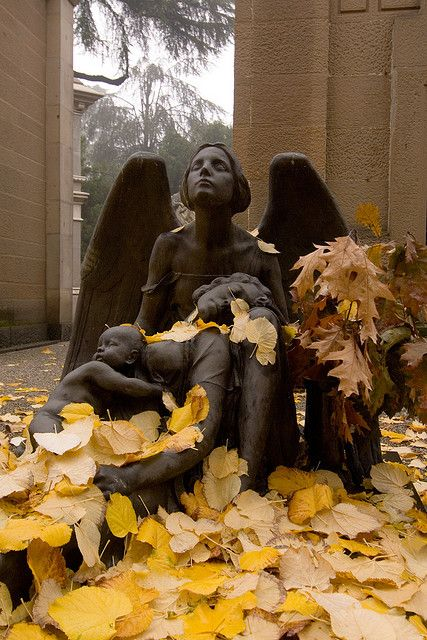 Angel cares for mother and child at Cimitero Monumentale, Milano, Italy.  Photo by Arturo Bragaja.