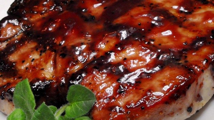 Boneless pork loin chops, marinated in a tangy sweet-and-savory marinade with a hint of spice, grill up all moist and browned for a delightful grilled supper for two.