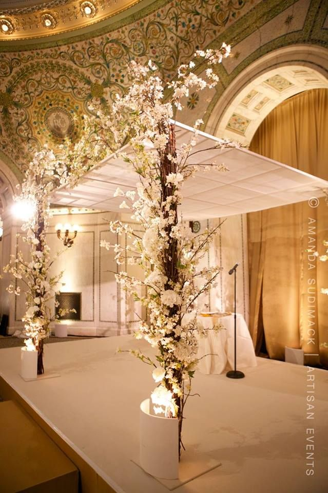 You could use flowers in front like these and draping in back??? The whole thing could be taller. It could be a mandap